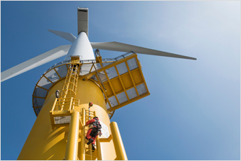 Engineers climbing a wind turbine